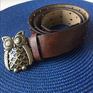 "Medium brown studded laser cut belt. 1 1/2"" W x40"""